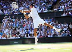 Novak Djokovic in action against Juan Martin Del Potro  during his win in the semi-final at the Wimbledon Tennis Championships in London, Friday, 5th July 2013<br /> Picture by Stephen Lock / i-Images