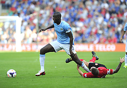 Manchester City's Yaya Touré out muscles Cardiff City's Craig Bellamy  - Photo mandatory by-line: Joe Meredith/JMP - Tel: Mobile: 07966 386802 25/08/2013 - SPORT - FOOTBALL - Cardiff City Stadium - Cardiff -  Cardiff City V Manchester City - Barclays Premier League