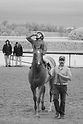The winning jockey saying a little prayer while his horse is led to the winner's circle at Keeneland Race Course, Lexington, KY.  Infrared (IR) photograph by fine art photographer Michael Kloth. Black and white infrared photographs