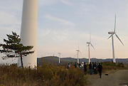 """Eco World Kuzumaki Wind Power Station. Built in 2003 the plant generates 2 million kilowatt hours of electricity per year. Kuzumaki in Northern Japan bills itself as a town of """"Milk, wine and clean energy"""". The 8000 population town has little local industry so Kuzumaki invited Japanese companies to set up wind, solar and biogas generating plants."""