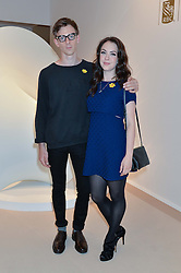 ELIZABETH HOPPER and JAMES NORTHCOTE at the Masterpiece Marie Curie Party supported by Jeager-LeCoultre held at the South Grounds of The Royal Hospital Chelsea, London on 30th June 2014.