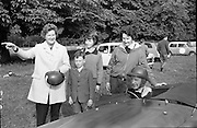 Phoenix Park Motor Race Practice.  Mrs. Joe Flynn and her children turned out at dawn to watch her husband race in an A.C. Bristol during the practise for the Gold Flake Trophy Race.<br /> 12.07.1962