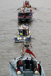 © Licensed to London News Pictures. 11/06/2016. The Queen's row barge Gloriana has led a Thames flotilla of heritage vessels through Tower Bridge to mark the Queen's birthday. The river procession also included Havengore, classic fireboat Massey Shaw, traditional Thames cutters and a dozen Dunkirk little ships. Credit: Rob Powell/LNP