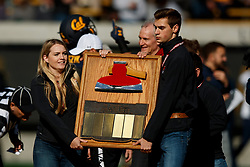 BERKELEY, CA - DECEMBER 01:  Members of the Stanford Axe committee hold the Stanford Axe at midfield turn the coin toss before the game against the California Golden Bears at California Memorial Stadium on December 1, 2018 in Berkeley, California. (Photo by Jason O. Watson/Getty Images) *** Local Caption ***