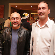 Phillip Zampino, left,and Matthew Gould pose for a picture Sunday December 21, 2014 during the Brooklyn Arts District Christmas party at Canape in Wilmington, N.C. (Jason A. Frizzelle)