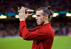 CARDIFF, WALES - Thursday, October 11, 2018: Wales' records men's goal scorer Gareth Bale is presented with a golden boot during the International Friendly match between Wales and Spain at the Principality Stadium. (Pic by David Rawcliffe/Propaganda)