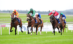 Castle Guest ridden by Robert Smithers (centre) before winning the O'Brien's Wines Handicap at Curragh Racecourse, Co. Kildare, Ireland.
