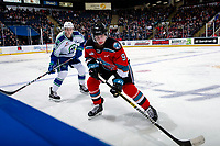 KELOWNA, BC - OCTOBER 16:  Hayden Ostir #26 of the Swift Current Broncos back checks Mark Liwiski #9 of the Kelowna Rockets at the boards during first period at Prospera Place on October 16, 2019 in Kelowna, Canada. (Photo by Marissa Baecker/Shoot the Breeze)