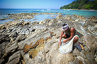 Fisherman in the Andaman Islands tends to his nets