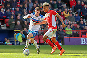 Charlton Athletic attacker Lyle Taylor (9) dribbling and on his way to score a goal during the EFL Sky Bet League 1 match between Charlton Athletic and Rochdale at The Valley, London, England on 4 May 2019.