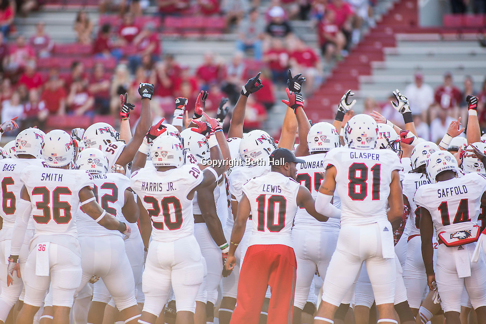Sep 20, 2014; Fayetteville, AR, USA; The Northern Illinois University Huskies team gathers together before a game against the Arkansas Razorbacks at Donald W. Reynolds Razorback Stadium. Arkansas defeated NIU 52-14. Mandatory Credit: Beth Hall-USA TODAY Sports