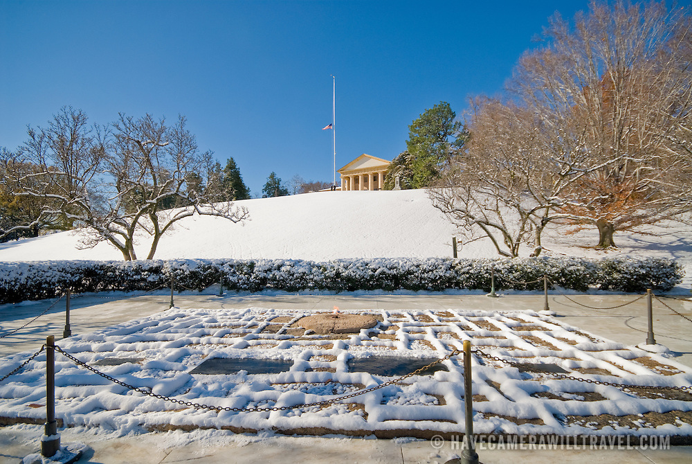 John F. Kennedy gravesite with Arlington House (also know as Custis-Lee Mansion) in the background at Arlington National Cemetery, Washington DC