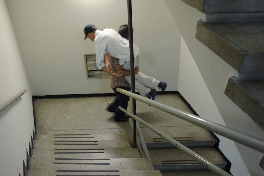 Due to Maickel's low muscle tone he needs help in certain situations like walking down big steps. September 2nd, 2011.
