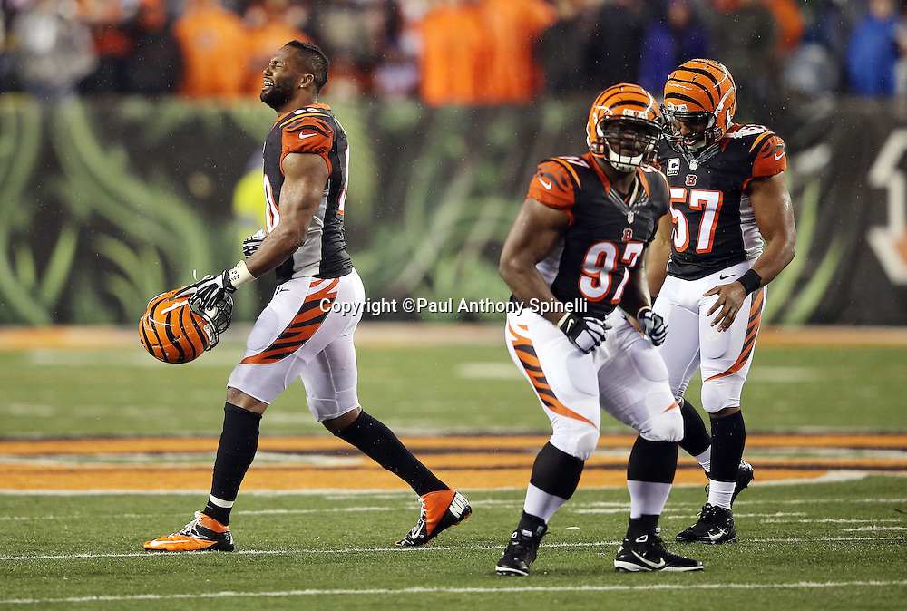 Cincinnati Bengals defensive end Michael Johnson (90) grimaces in anguish as the Bengals get called for a second penalty after a hard hit on Pittsburgh Steelers wide receiver Antonio Brown (84) at the end of the game by Cincinnati Bengals outside linebacker Vontaze Burfict (55) that causes altercations on the field during the NFL AFC Wild Card playoff football game against the Cincinnati Bengals on Saturday, Jan. 9, 2016 in Cincinnati. The Steelers won the game 18-16. (©Paul Anthony Spinelli)