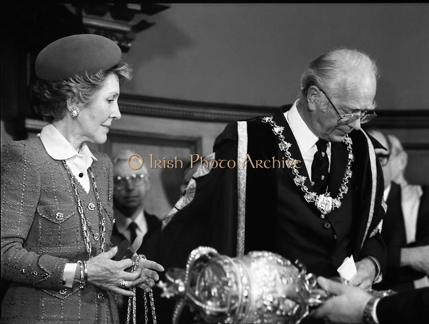 Nancy Reagan .Visits the Royal College Of Surgeons..St Stephens Green,.1984..04.06.1984.06.04.1984.4th June 1984..Nancy Reagan visited the Royal College of Surgeons where she unveilled a portrait of her late father.Her father, Dr Loyal Davis was an Honorary Fellow of the college. Mrs Reagan then presented the portrait to the college..Photo of Mrs Reagan and professor O'malley as they prepare to leave the stage. Also in the shot is the removal of the college mace.