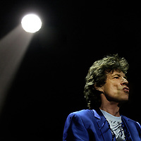 "Rolling Stones lead singer Mick Jagger sings ""Start Me Up"" during the opening song of the ""Lick World Tour"" at the Office Depot Center, Tuesday, Oct. 22. 2002. in Sunrise, Fla. (Photo/ Steve Mitchell)"