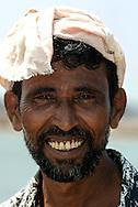 Worker at Mangalore fish market, India