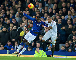 LIVERPOOL, ENGLAND - Sunday, January 24, 2016: Everton's Romelu Lukaku in action against Swansea City's captain Ashley Williams during the Premier League match at Goodison Park. (Pic by David Rawcliffe/Propaganda)