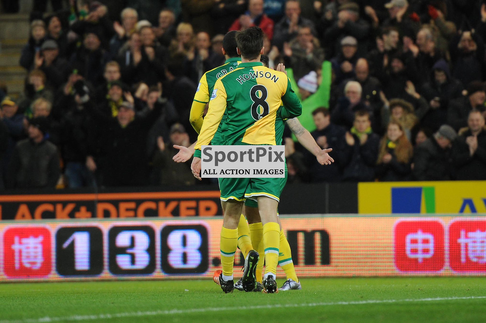 Norwichs Lewis Grabban celebrates his equaliser for Norwich with his teammates during the Norwich v Arsenal game in the Barclays Premier League on Sunday 29th November 2015 at Carrow Road