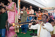 18 MAY 2008 -- MARICOPA, AZ: Musicians play as people process into the temple during the dedication of the new Hindu temple in Maricopa, AZ, Sunday. More than 3,000 Hindus from Arizona, southern California and New Mexico came to Maricopa, AZ, a small town in the desert about 50 miles south of Phoenix, for the dedication of the Maha Ganapati Temple of Arizona. It is the first Hindu temple in Arizona designed according to ancient South Indian Hindu architectural guides. Craftsmen from India came to Maricopa to complete the interior details of the temple. The dedication ceremonies lasted three days.   Photo by Jack Kurtz / ZUMA Press