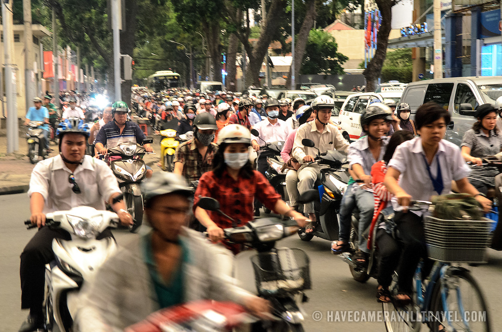 A sea of scooters and bikes in Ho Chi Minh City''s afternoon rush hour.