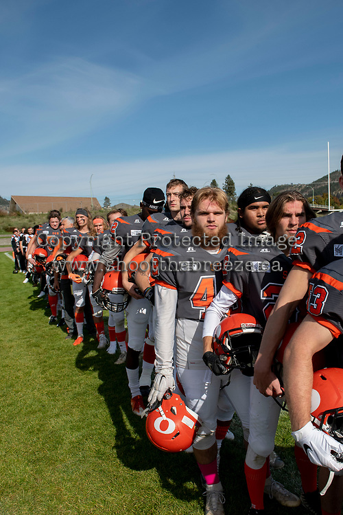 KELOWNA, BC - OCTOBER 6: The Okanagan Sun stand on the sidelines for the national anthem against the VI Raiders at the Apple Bowl on October 6, 2019 in Kelowna, Canada. (Photo by Marissa Baecker/Shoot the Breeze)