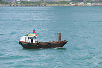 Sampan in harbour, Hong Kong, Hong Kong, August 2008   Photo: Peter Llewellyn