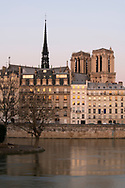 An early morning view over the Seine to the Il de la Cite and the towers of Notre-Dame Cathedral. Paris, France, Europe
