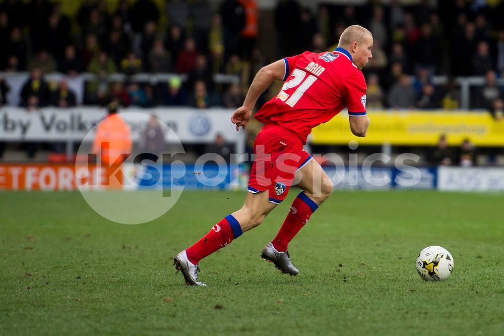 Eoghan O'Connell of Oldham Athletic AFC in action during the Sky Bet League 1 match between Burton Albion and Oldham Athletic at the Pirelli Stadium, Burton upon Trent, England on 26 March 2016. Photo by Brandon Griffiths.