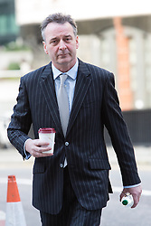 © Licensed to London News Pictures. 17/03/2014. London, UK. Jonathan Laidlaw arrives at The Old Bailey in London this morning, 17th March 2014 for the Phone Hacking Trial. Photo credit : Vickie Flores/LNP