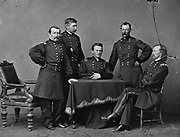 General Philip Sheridan (1831-1888), standing right, and his Staff officers during the American Civil War 1860-1865.  American Army officer and Union (Northern) general.