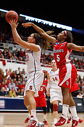 March 21, 2011; Stanford, CA, USA; Stanford Cardinal guard Jeanette Pohlen (23) shoots past St. John's Red Storm guard Nadirah McKenith (5) during the first half of the second round of the 2011 NCAA women's basketball tournament at Maples Pavilion.