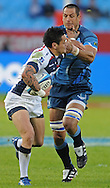 PRETORIA, South Africa, 14 May 2011. Pierre Spies of the Bulls is handed off by Richard Kingi of the Melbourne Rebels during the Super15 Rugby match between the Bulls and the Melbourne Rebels at Loftus Versfeld in Pretoria, South Africa on 14 May 2011..Photographer : Anton de Villiers / SPORTZPICS