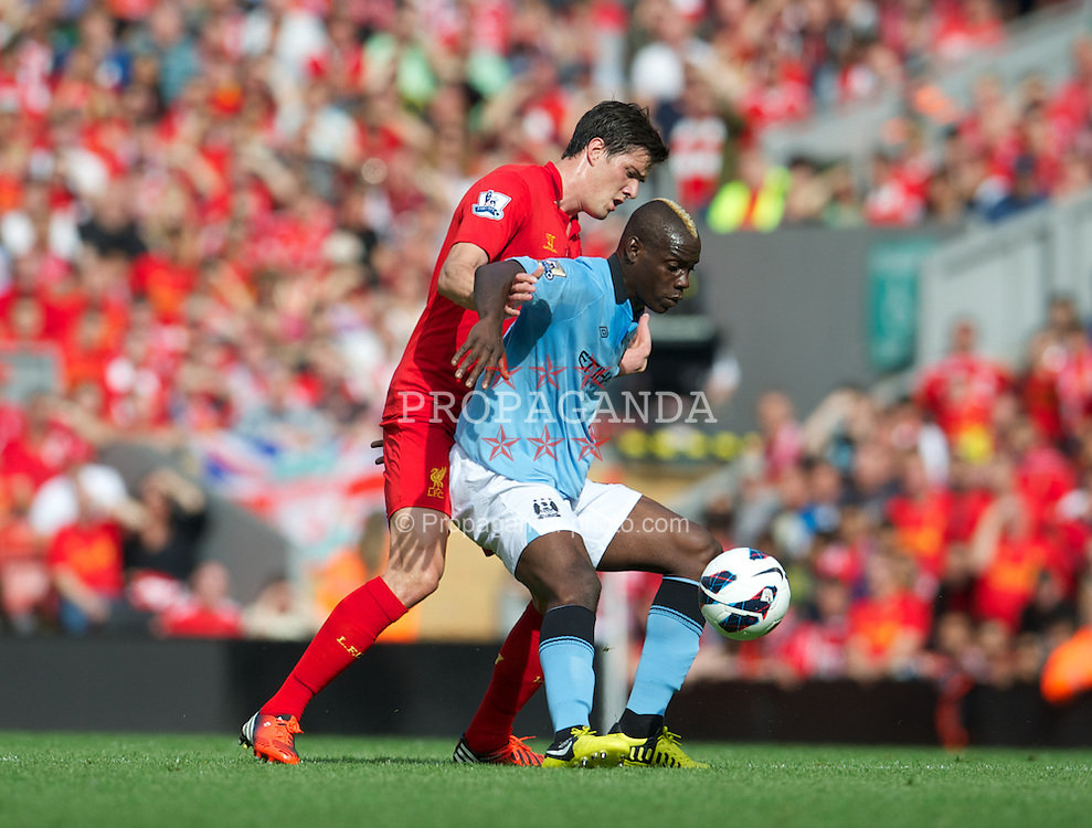 LIVERPOOL, ENGLAND - Sunday, August 26, 2012: Liverpool's Martin Kelly in action against Manchester City's Mario Balotelli during the Premiership match at Anfield. (Pic by David Rawcliffe/Propaganda)
