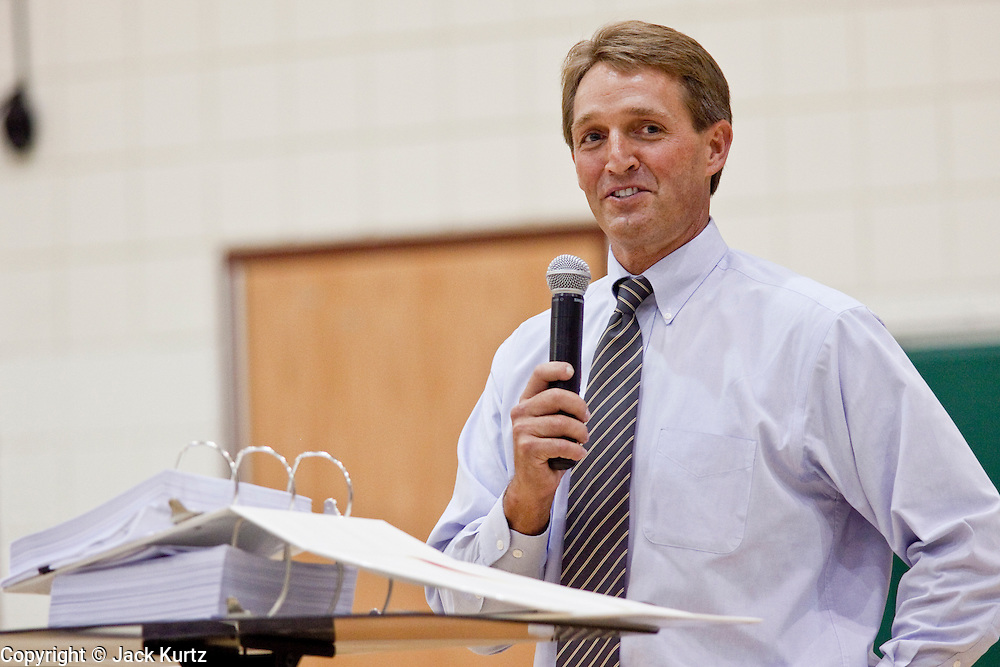 """Aug 10, 2009 -- CHANDLER, AZ: Congressman JEFF FLAKE speaks from a podium with a copy of the health care reform bill in front of him. Rep. Flake, (R-AZ) hosted a """"town hall"""" style meeting on health care reform at Basha High School in Chandler Monday. Flake, a conservative Republican, has opposed President Obama on many issues, like the stimulus and health care reform. Protestors who have shut down similar meetings hosted by Democrats, gave Flake a warm welome. About 1,600 people attended the meeting.   Photo by Jack Kurtz"""