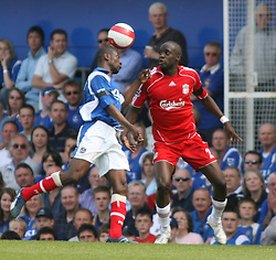 Portsmouth, England: Saturday, April 28, 2007: Liverpool's Momo Sissoko and Portsmouth's Lauren during the Premiership match at Fratton Park (Pic by Chris Ratcliffe/Propaganda)