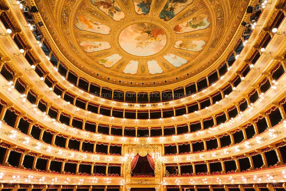 PALERMO, ITALY - 18 FEBRUARY 2018: A view of the auditorium and the wheel overlooking it (which looks like a giant flower with eleven petals that, thorough a system of ropes, can open up to let the hot air out and ventilate the room) is seen here from the stage of the Teatro Massimo in Palermo, Italy, on February 18th 2018.<br /> <br /> The Teatro Massimo Vittorio Emanuele is an opera house and opera company located  in Palermo, Sicily. It was dedicated to King Victor Emanuel II. It is the biggest in Italy, and one of the largest of Europe (the third after the Op&eacute;ra National de Paris and the K. K. Hof-Opernhaus in Vienna), renowned for its perfect acoustics. It was inaugurated in 1897.