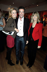 Left to right, KIM GARNER, HUBERT DE PELET and GERALDINE GARNER at the Linley Christmas party at their store at 60 Pimlico Road, London on 19th November 2008.