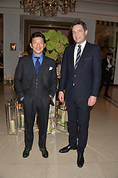 Left to right, WEI HOH and THOMAS KOCHS at a reception hosted by Wei Koh founder of The Rake Magazine and Thomas Kochs General Manager of Claridge's to celebrate London Collections: Man 2014 at Claridge's, Brook Street, London on 5th January 2014.