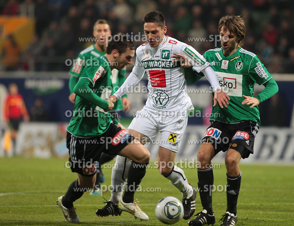 26.11.2011, Keine Sorgen Arena, Ried im Innkreis, AUT, 1.FBL, SV Josko Ried vs FC Wacker Innsbruck, im Bild (v.l.n.r.) Emanuel Schreiner, (SV Josko Ried, #19), Miran Burgic, (FC Wacker Innsbruck, #9) und Jan Marc Riegler, (SV Josko Ried, #14), EXPA Pictures © 2011, PhotoCredit: EXPA/ R. Hackl