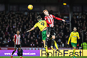 Brentford Midfielder Ryan Woods (15) wins the header against Norwich City Forward Nélson Oliveira (9) during the EFL Sky Bet Championship match between Brentford and Norwich City at Griffin Park, London, England on 27 January 2018. Photo by Stephen Wright.