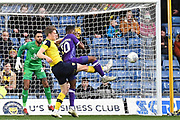 Oxford United defender Rob Dickie (4) clears the ball under pressure from Shrewsbury Town forward Fejiri Okenabirhie (10) during the EFL Sky Bet League 1 match between Oxford United and Shrewsbury Town at the Kassam Stadium, Oxford, England on 7 December 2019.