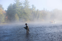 Fly-fishing from a driftboat near Moosehead Lake Maine USA (MR)