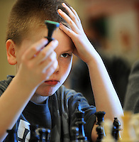 8 year old Dylan Freund of Fond du Lac, practices his game as he waits for tournament play during the Wisconsin Scholastic Chess Federations tournament held at Chegwin elementary school in Fond du Lac. Saturday, February 25, 2012. The Reporter photo by Patrick Flood.