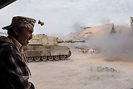 Libya, Sirte: A tank of the Libyan forces affiliated to the Tripoli government shoots at ISIS positions in Al Jiza neighbourhood on November 26, 2016.  Alessio Romenzi