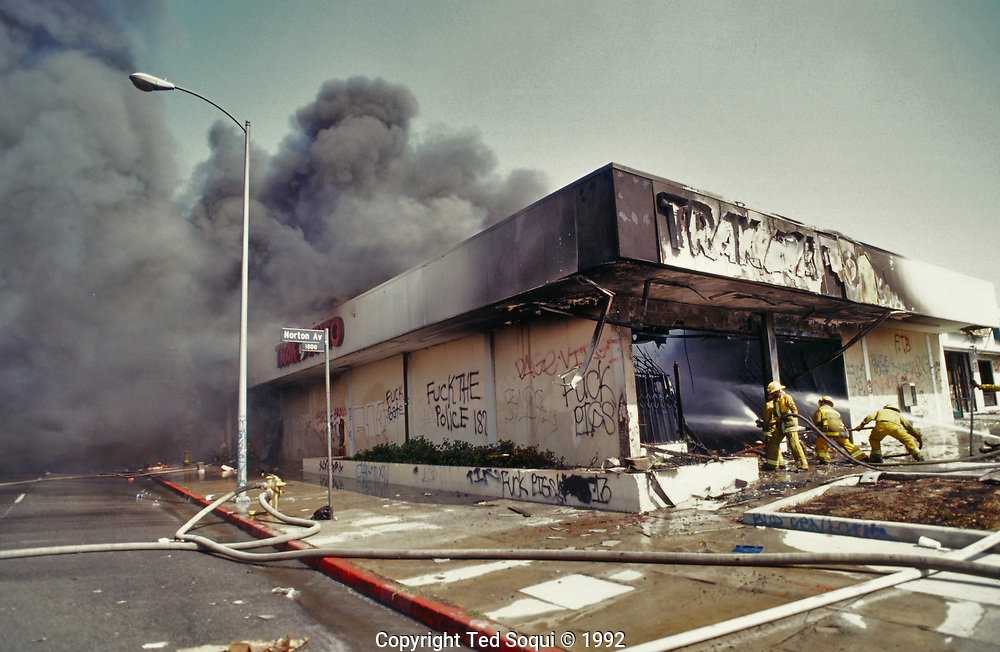 A Trak Auto store On W. Washington Blvd near Norton<br /> burns to the ground.<br /> Los Angeles has undergone several days of rioting due to the acquittal of the LAPD officers who beat Rodney King.<br /> Hundreds of businesses were burned to the ground and over 55 people have been killed.