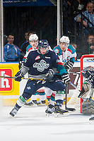KELOWNA, CANADA - JANUARY 16: Madison Bowey #4 of Kelowna Rockets back checks Ethan Bear #25 of Seattle Thunderbirds on January 16, 2015 at Prospera Place in Kelowna, British Columbia, Canada.  (Photo by Marissa Baecker/Shoot the Breeze)  *** Local Caption *** Madison Bowey; Ethan Bear;