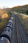 Illinois USA, A freight train along the Mississippi river near Savannah, IL. October 2006