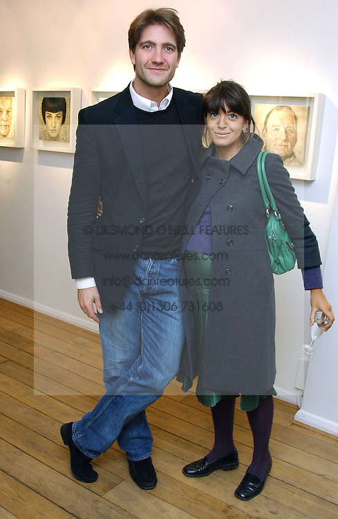KRIS THYKIER and CLAUDIA WINKLEMAN at an exhibition of artist Jonathan Yeo's portrait paintings held at Eleven, 11 Eccleston Street, London SW1 on 16th February 2006.<br />