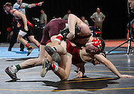 07 MARCH 2009: Augsburg's Jared Massey (top) scores a takedown against Coe's Rob Kramer in the 197-pound quarterfinal at the 2009 NCAA Division III Wrestling Championships at the US Cellular Center in Cedar Rapids, Iowa on Friday March 7, 2009. Massey won 12-1.